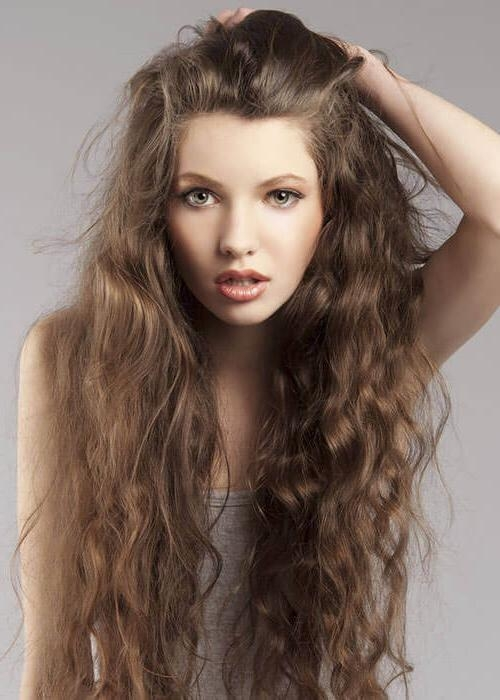 15 Tried And True Hairstyles For Long Curly Hair Intended For Long Hairstyles For Curly Hair (View 3 of 15)