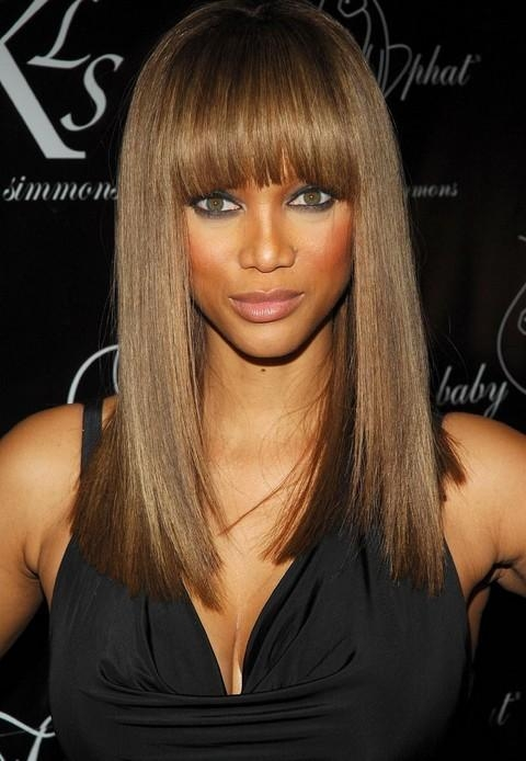 Latest Long Hairstyles With Bangs For Black Women Intended For Tyra Banks' Long Hairstyle: Straight Hairstyle With Blunt Bangs (View 10 of 15)