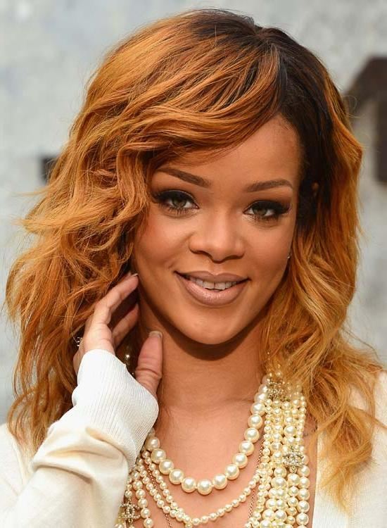 Most Current Rihanna Side Swept Big Curly Bob Hairstyles Throughout 50 Best Rihanna Hairstyles (View 11 of 15)