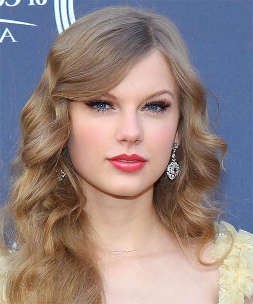 2018 Taylor Swift Long Hairstyles Regarding Taylor Swift Long Wavy Formal Hairstyle With Side Swept Bangs (View 5 of 15)