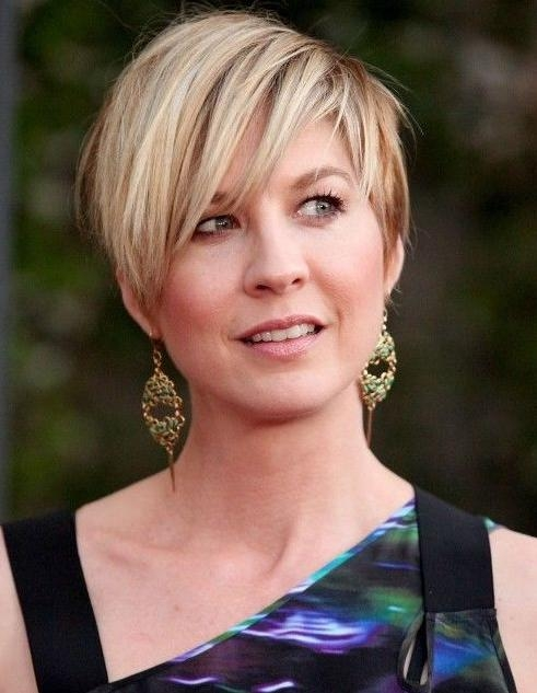 Casual Short Straight Haircut With Long Side Sweeping Bangs Pertaining To Short Haircuts With Long Side Bangs (View 14 of 20)