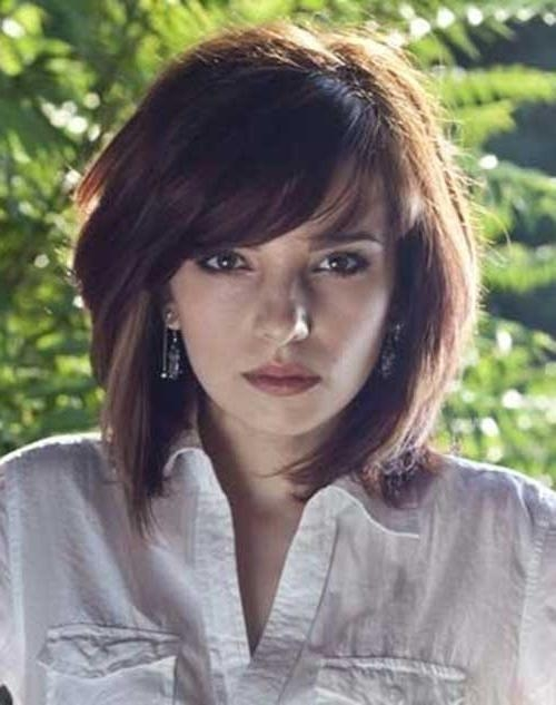 Featured Photo of Short Haircuts For Thick Hair With Bangs