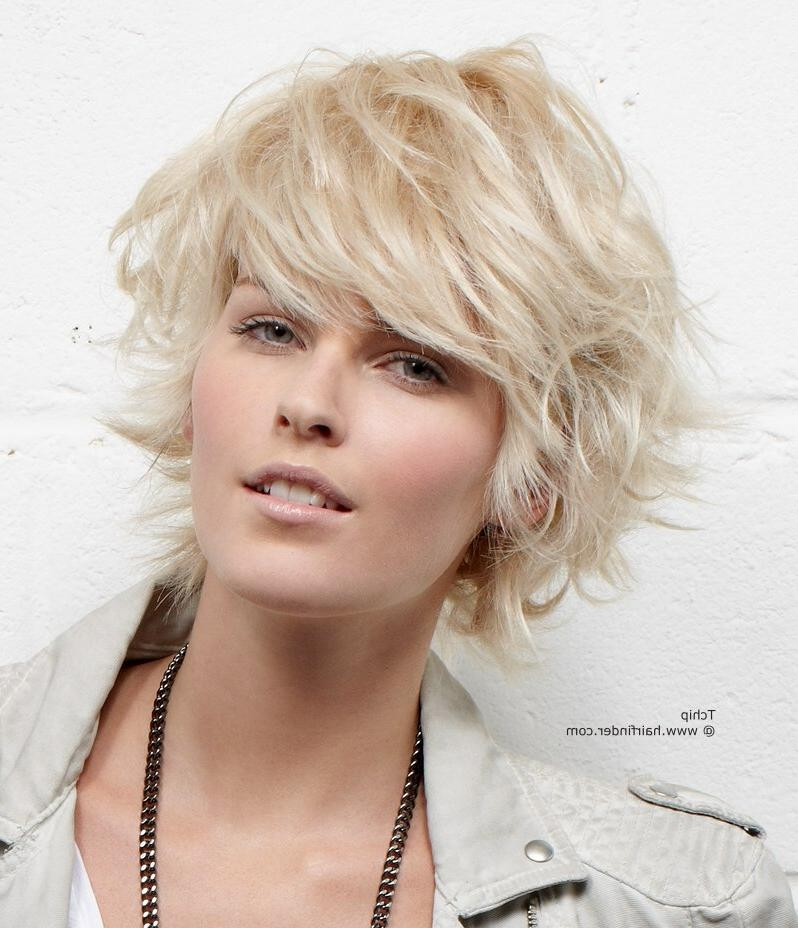 Feathery Short Haircut With The Ends Flipped Up And Out In Flipped Short Hairstyles (View 6 of 20)