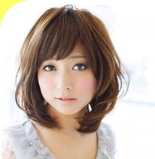 Sleek Hairstyle With Sideswept Bangs For Asian Women Round Face