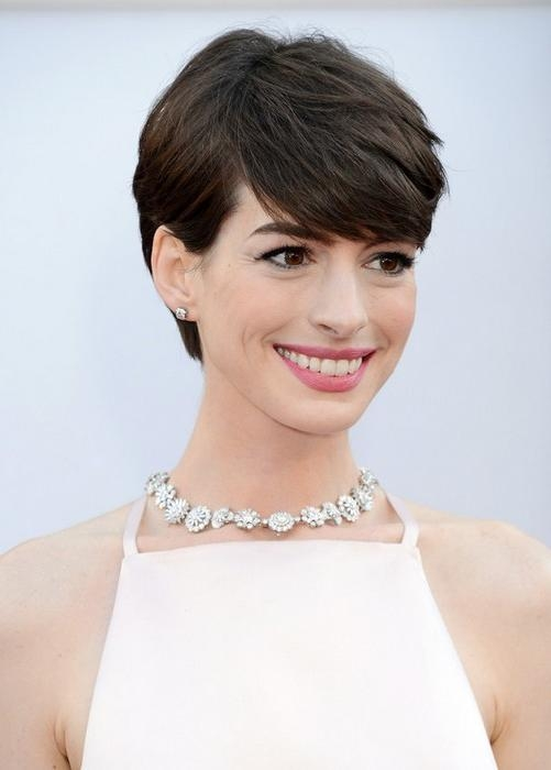 Fashionable Pixie Haircuts For Thick Straight Hair Inside Short Hairstyles For 2014: Cute Layered Pixie Cut With Bangs For (View 7 of 20)