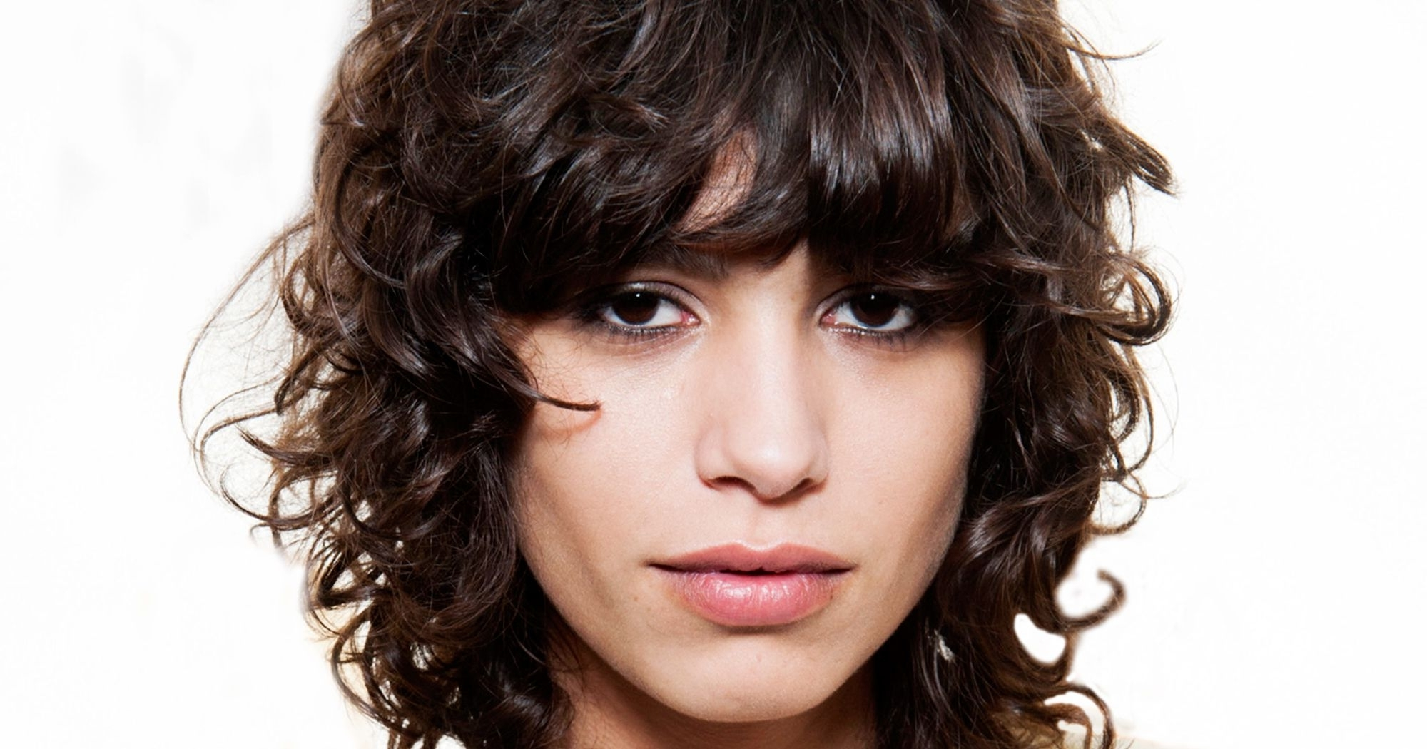 Most Up To Date Shaggy Wavy Hairstyles Pertaining To Curly Bangs Trend Pictures (View 8 of 15)