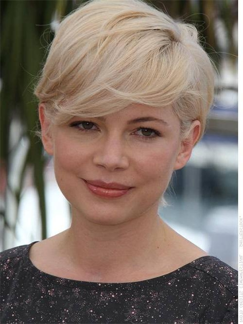 New Haircuts To Try For 2018 Within Fashionable Pixie Haircuts With Long Side Swept Bangs (View 17 of 20)