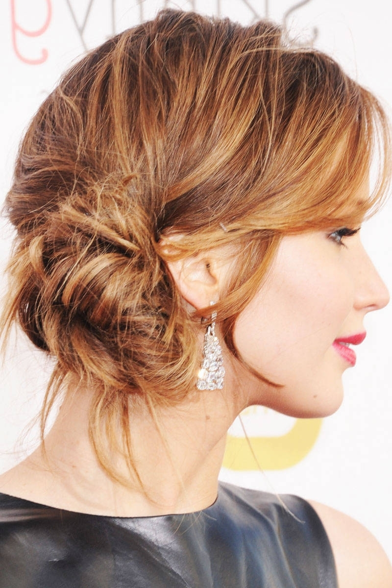 1 Girl, 3 Styles: Jennifer Lawrence | Side Bun Updo, Jennifer Intended For Low Bun Updo Wedding Hairstyles (View 1 of 15)