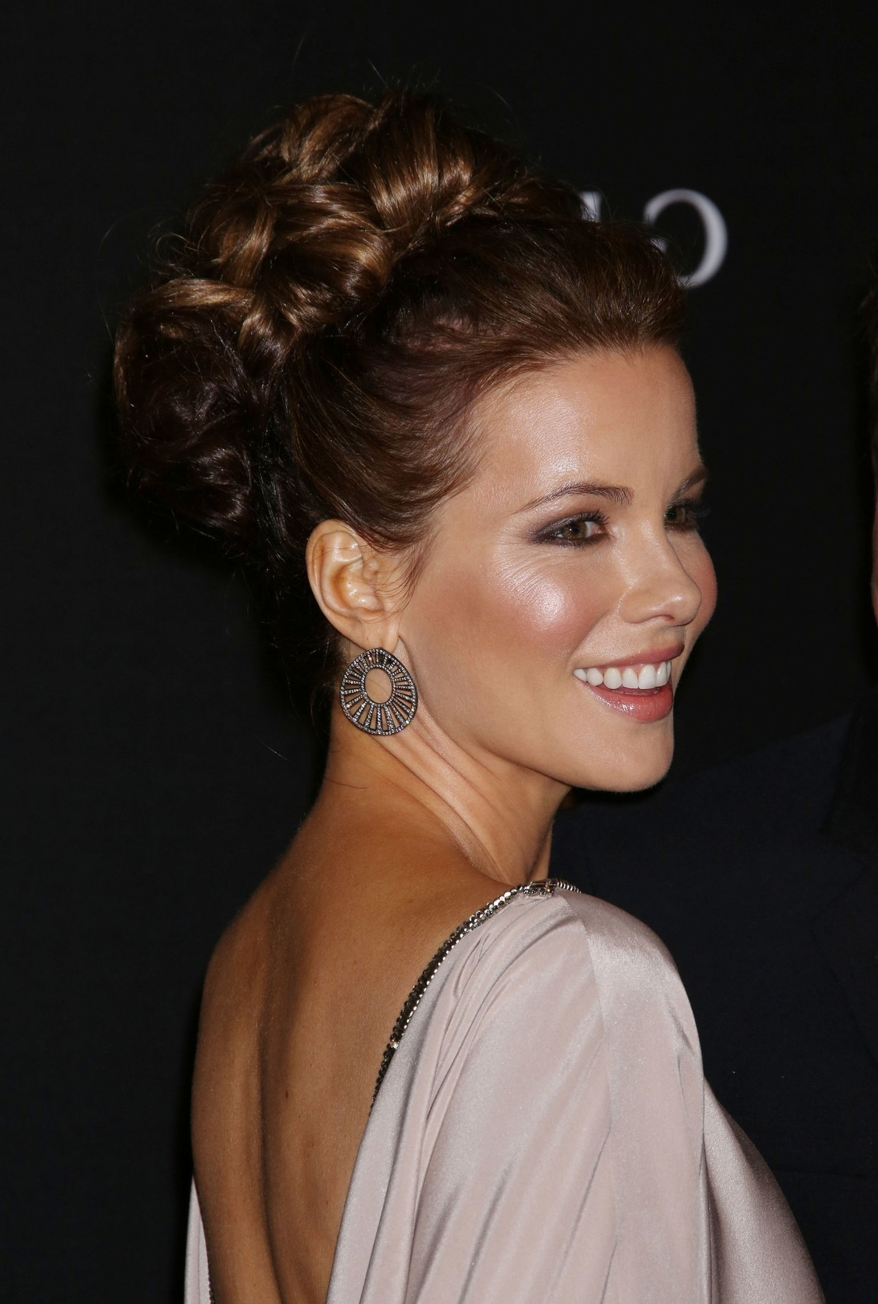 Today's Most Pinnable Hairstyle: Kate Beckinsale's Knotted Bun Updo In Updo Bun Hairstyles (View 11 of 15)