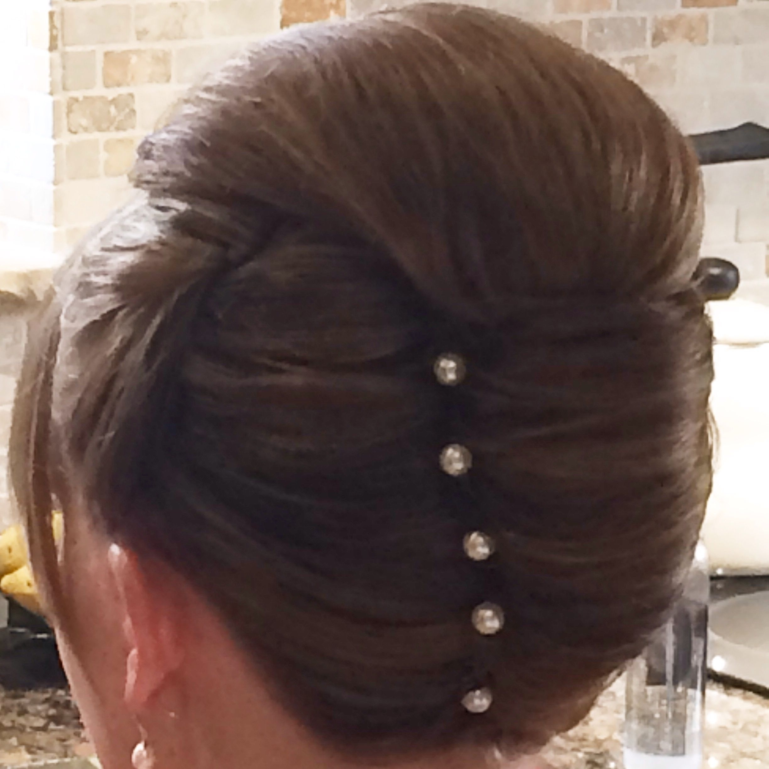 2017 Roll Hairstyles For Wedding Pertaining To Vertical Roll Wedding Hair (View 2 of 15)