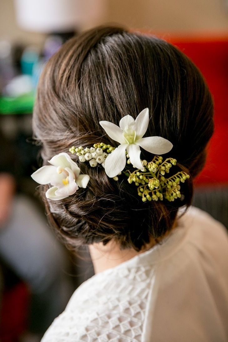 Elegant Updo With White Flowers (View 5 of 15)