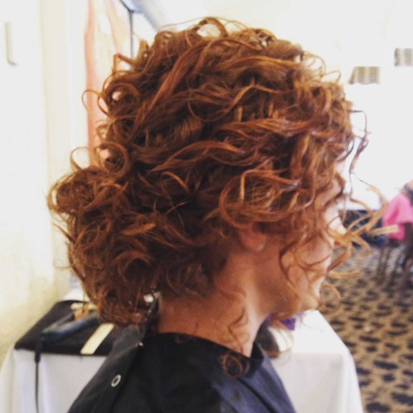 Naturally Curly Hair Low Bun Updo (View 13 of 15)