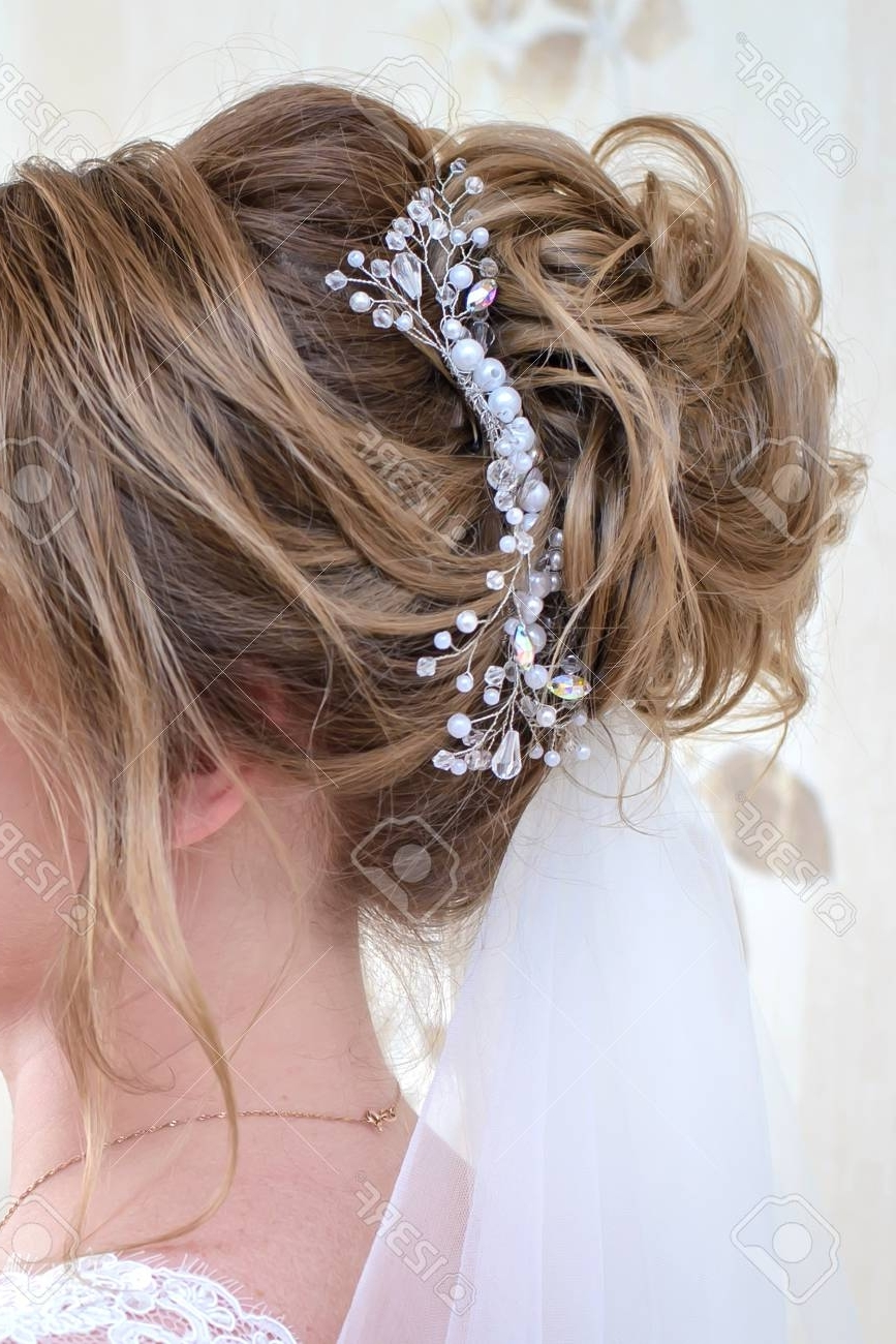 Wedding Hairstyle For Long Blonde Hair With A Beautiful Ornament Regarding 2018 Wedding Hairstyles For Long Blonde Hair (View 15 of 15)