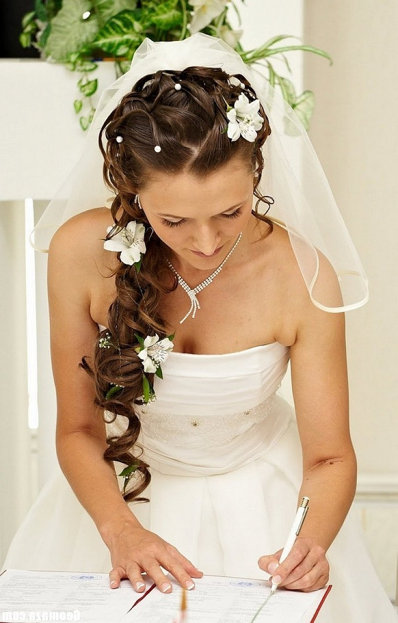 Wedding Hairstyles Ideas: Curly Elegant Half Up With Flowers And Regarding Favorite Wedding Hairstyles With Veil And Flower (View 11 of 15)