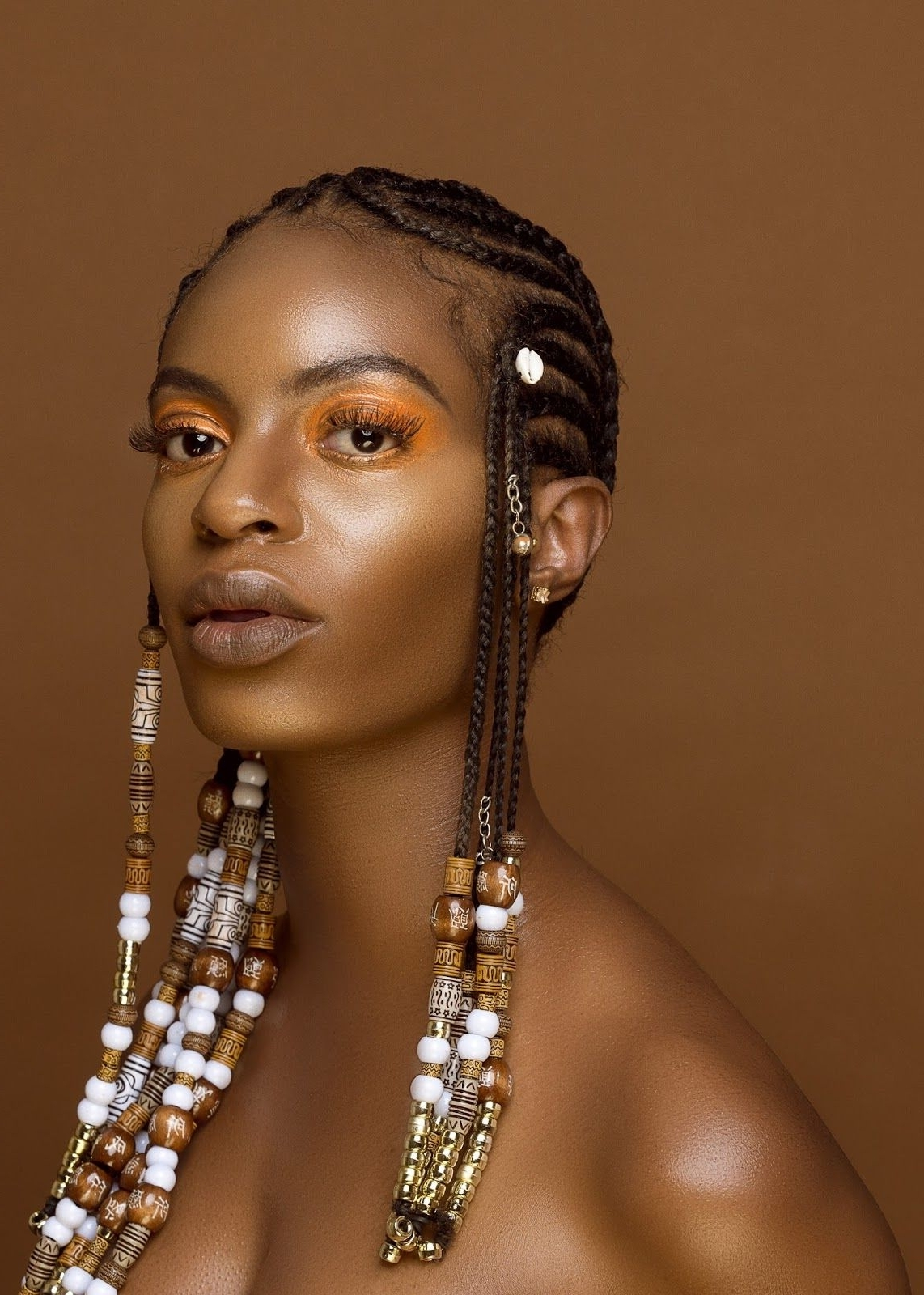 Popular Cornrows With Artistic Beaded Twisted Bun Inside 10 Inspirational Photos Of Braids With Beads And Cowrie Shells (View 12 of 15)