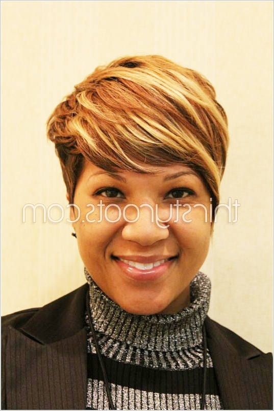 Short Haircut With Highlights In Best And Newest Long Honey Blonde And Black Pixie Haircuts (View 15 of 15)