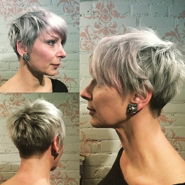 This Platinum Silver Pixie With Feathered Texture And Bangs Is A With Preferred Platinum Blonde Disheveled Pixie Haircuts (View 13 of 15)