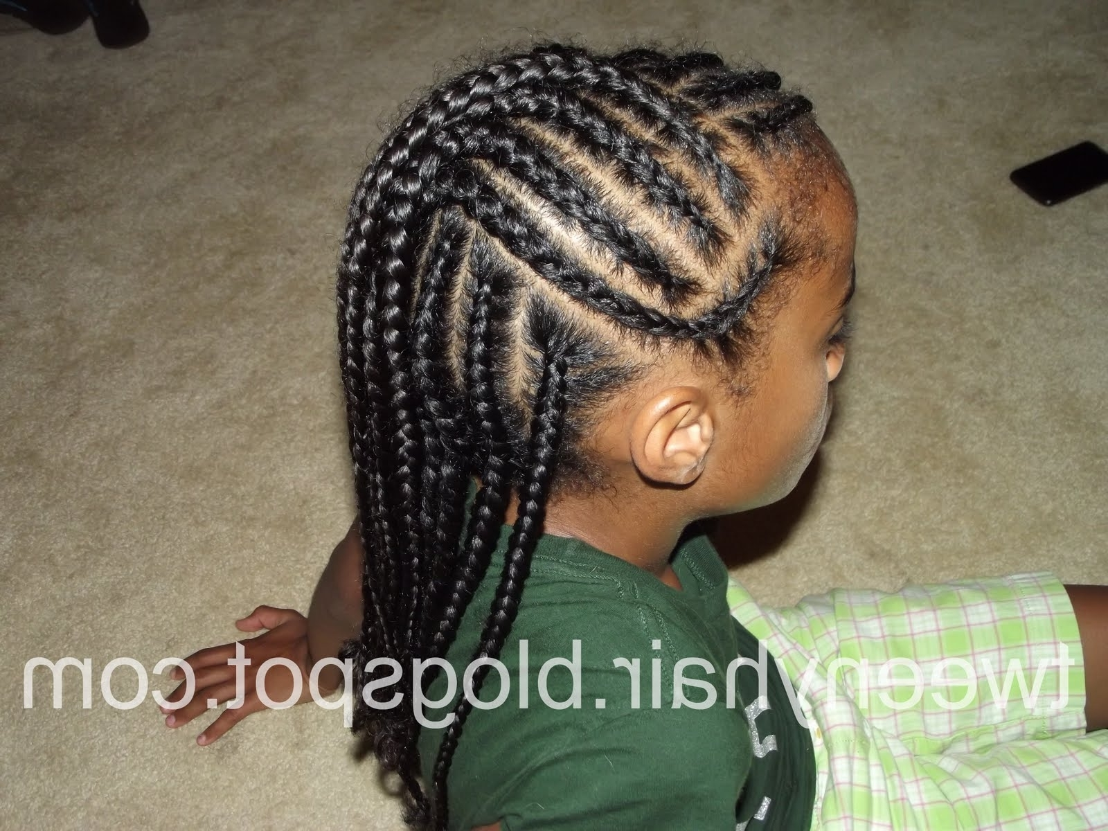 Trendy Cornrows Hairstyles Going Up In Tweeny Hair: Cornrows: Half Hawk, Half Down (View 13 of 15)