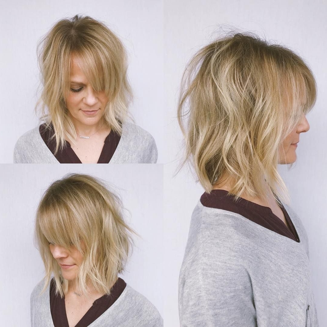 2017 Blonde Lob Hairstyles With Sweeping Bangs Pertaining To This Undone Wavy Textured Bob With Parted Side Swept Bangs And (View 2 of 20)