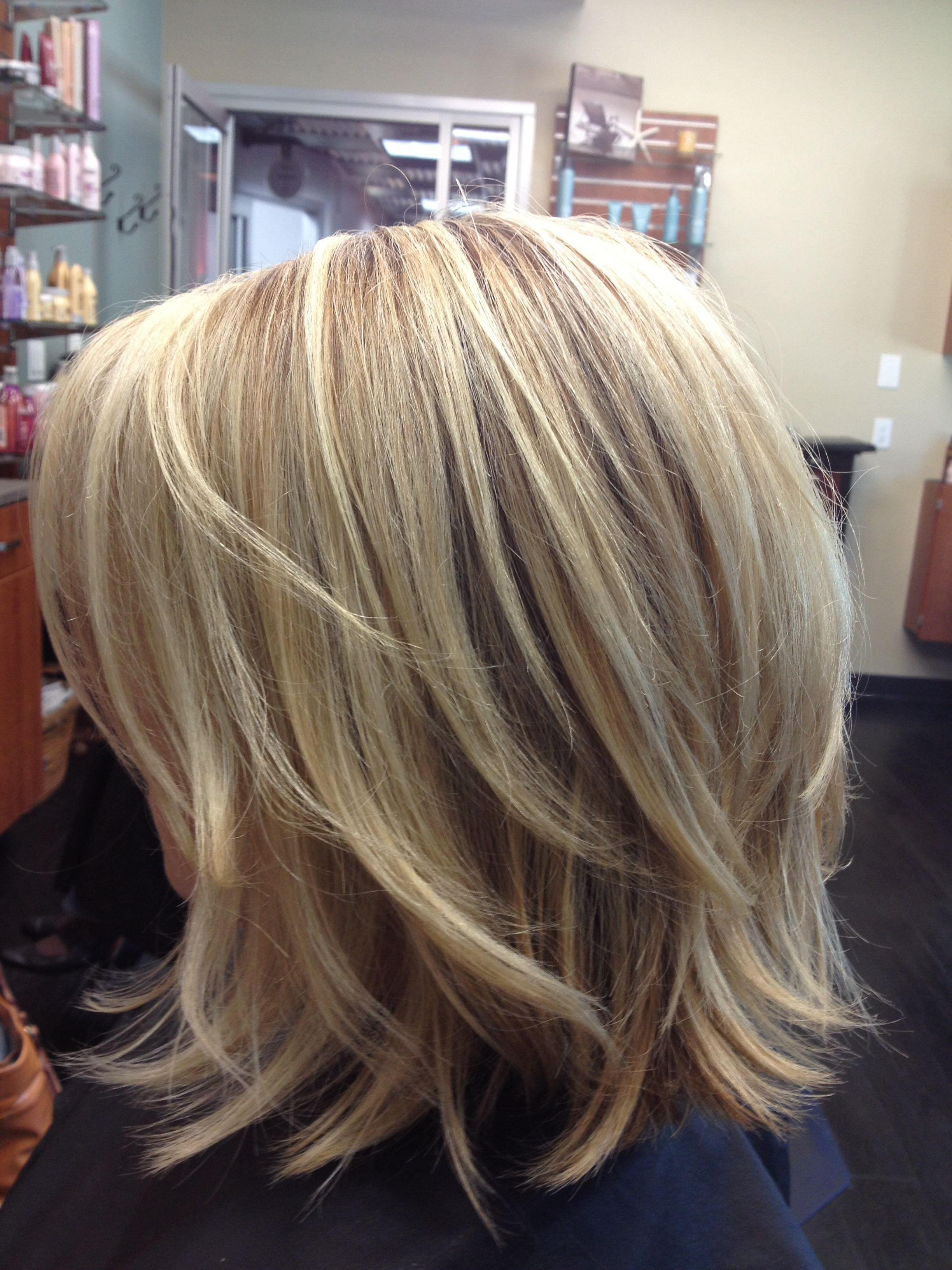 2017 Feathered Cut Blonde Hairstyles With Middle Part In 14 Trendy Medium Layered Hairstyles In  (View 1 of 20)
