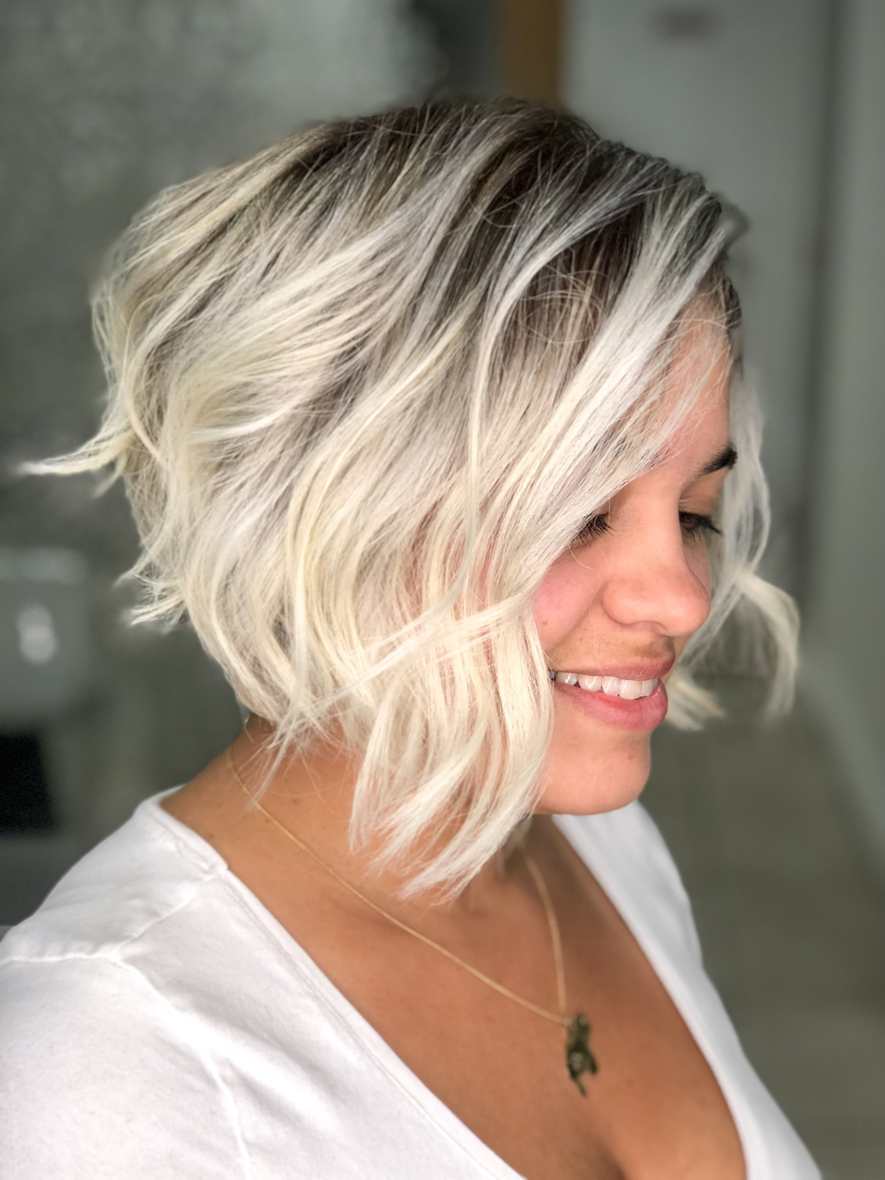 2017 Trendy Angled Blonde Haircuts In Cool Blonde Hair Color With Angled Bob Hair Cut And Waves (View 4 of 20)