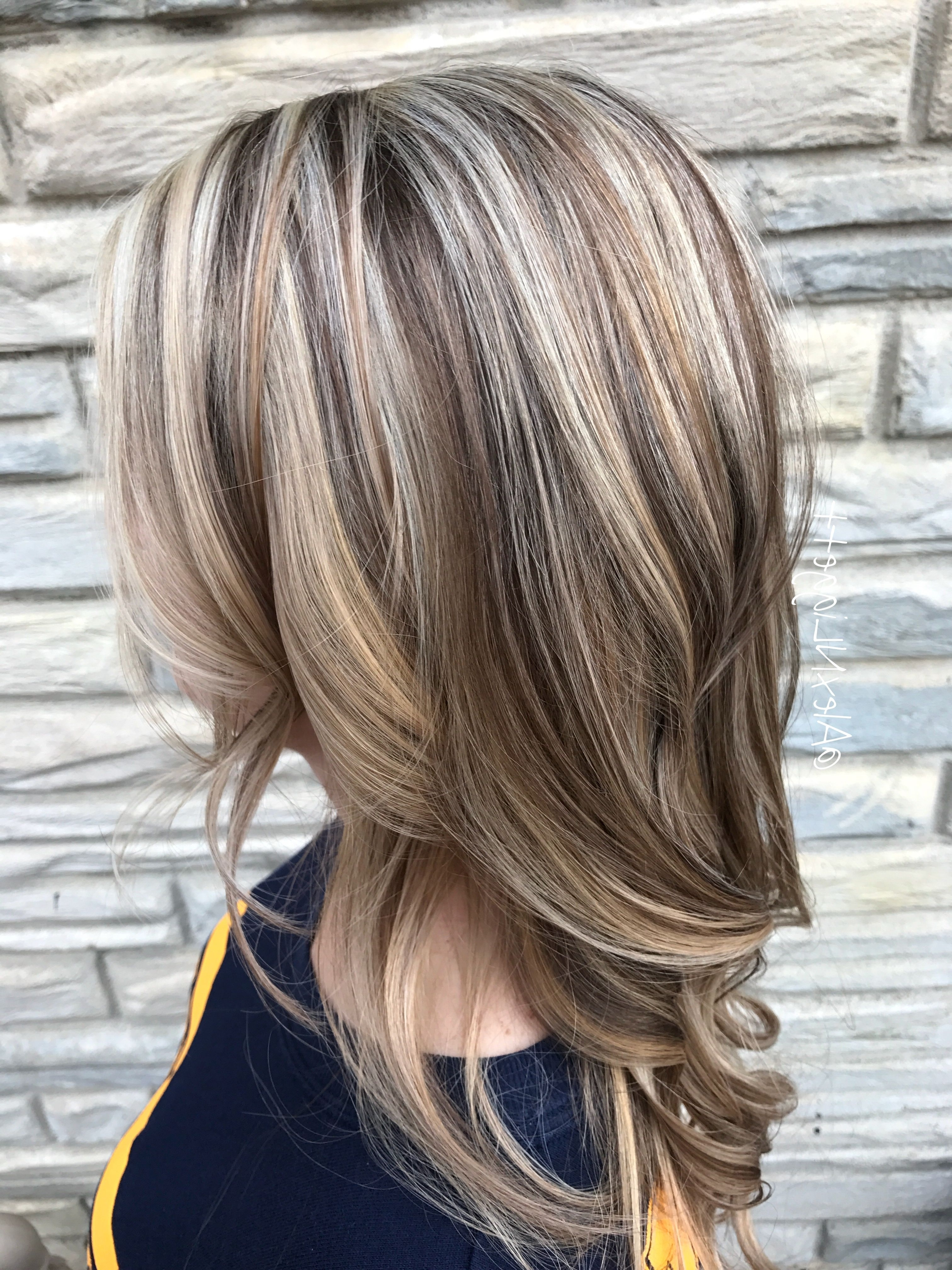 2018 Soft Layers And Side Tuck Blonde Hairstyles In Pinhairstyles Catalog On Highlights (View 11 of 20)
