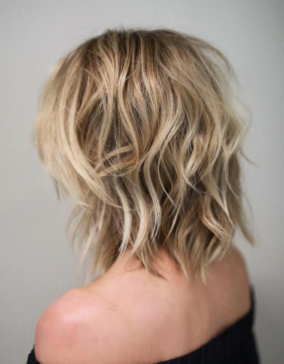 50 Best Variations Of A Medium Shag Haircut For Your Distinctive Style In Trendy Shoulder Grazing Strawberry Shag Blonde Hairstyles (View 11 of 20)
