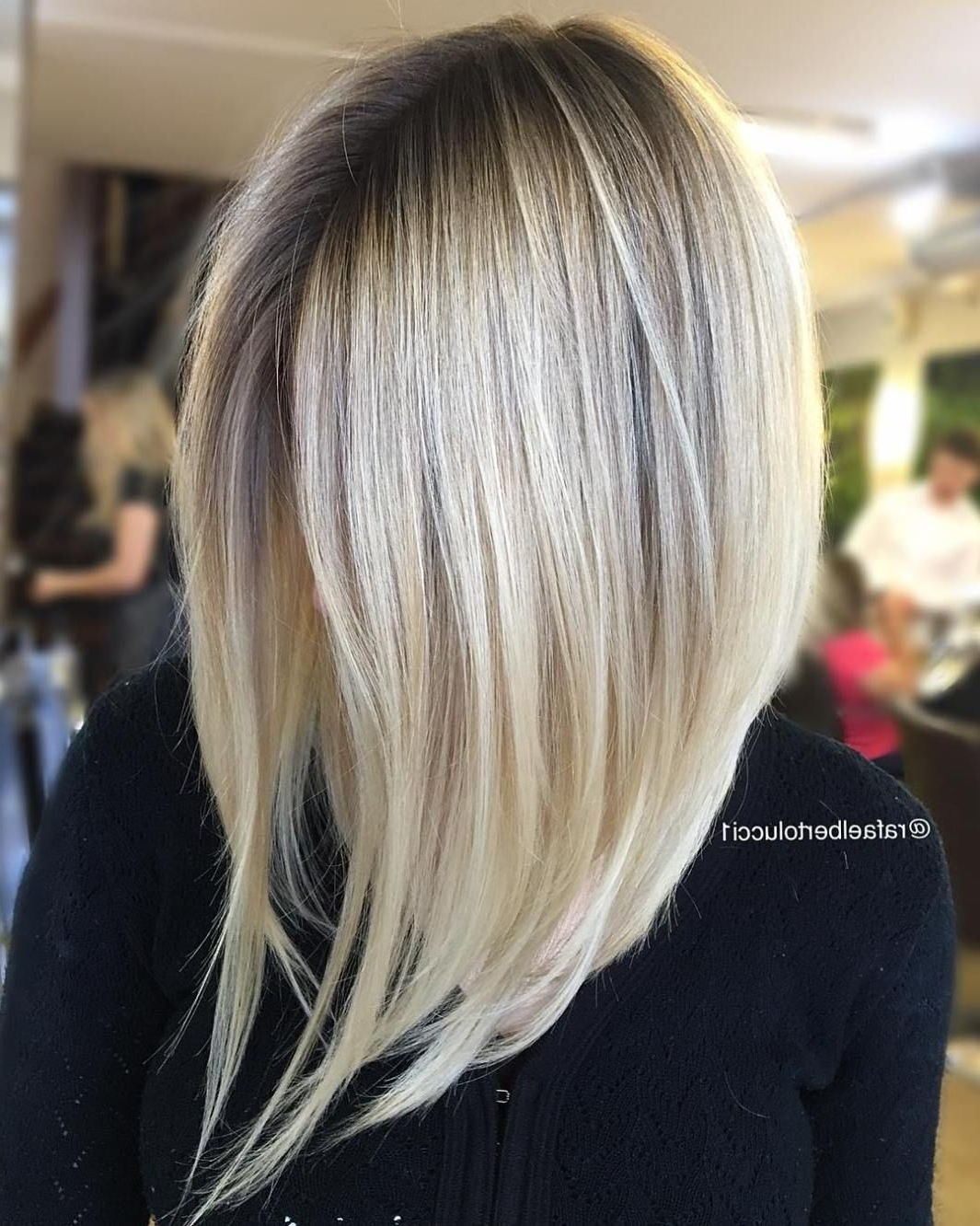 Featured Photo of Steeply Angled A Line Lob Blonde Hairstyles