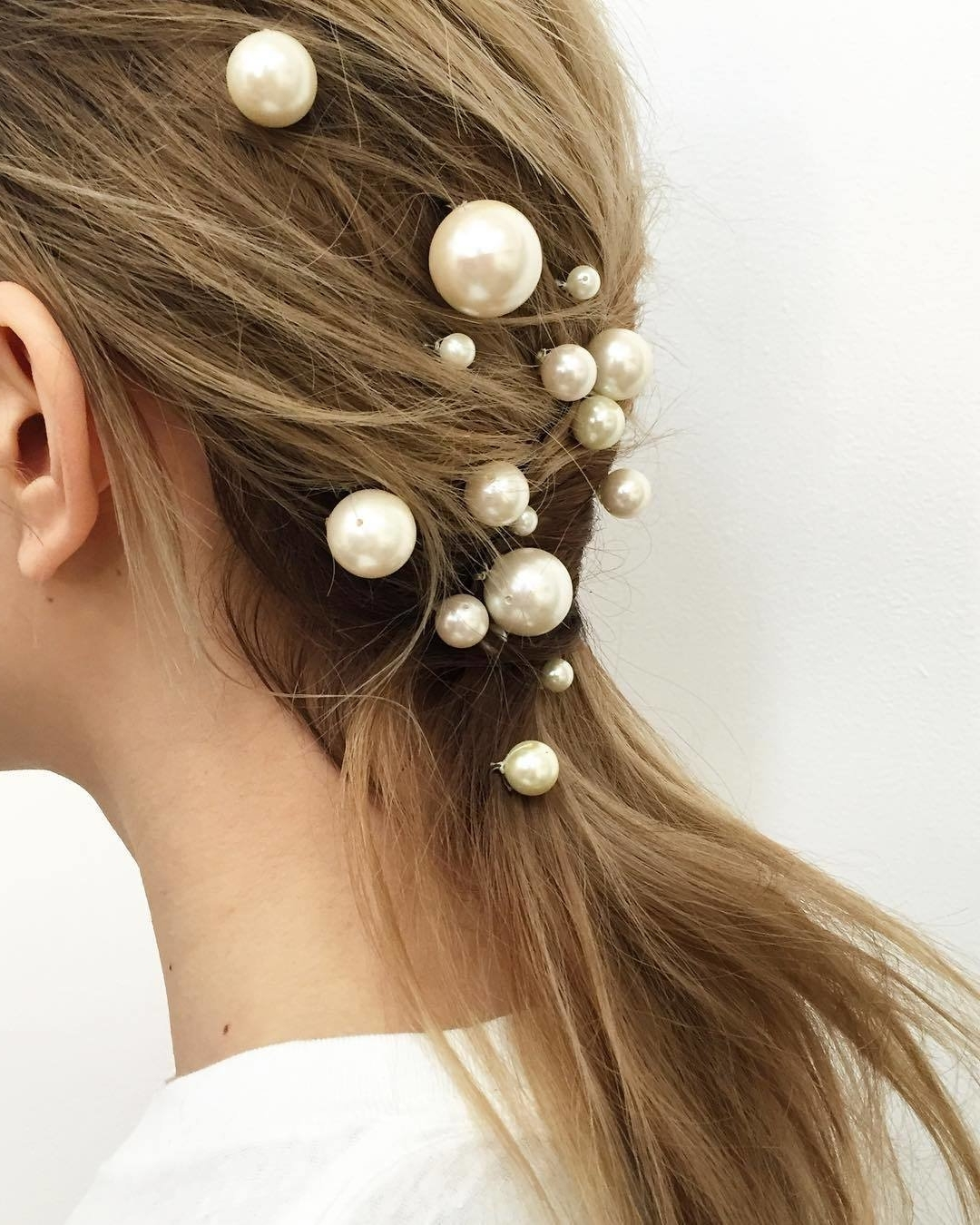 A Pinned Back Low Ponytail Is Made Insanely Elegant With Pearls With Regard To Current Hot High Rebellious Ponytail Hairstyles (Gallery 9 of 20)