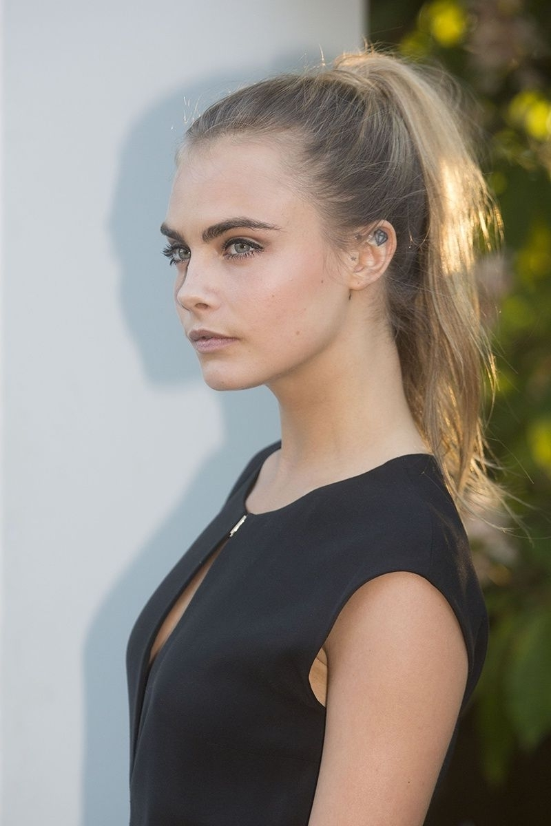 Cara Delevigne's Sleek High Ponytail Is Just Perfect For A Summer For 2017 High Sleek Ponytail Hairstyles (View 1 of 20)