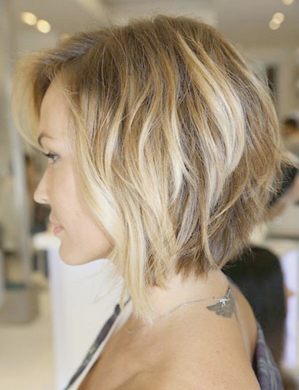 Photo Gallery Of Curly Angled Blonde Bob Hairstyles Viewing 11 Of
