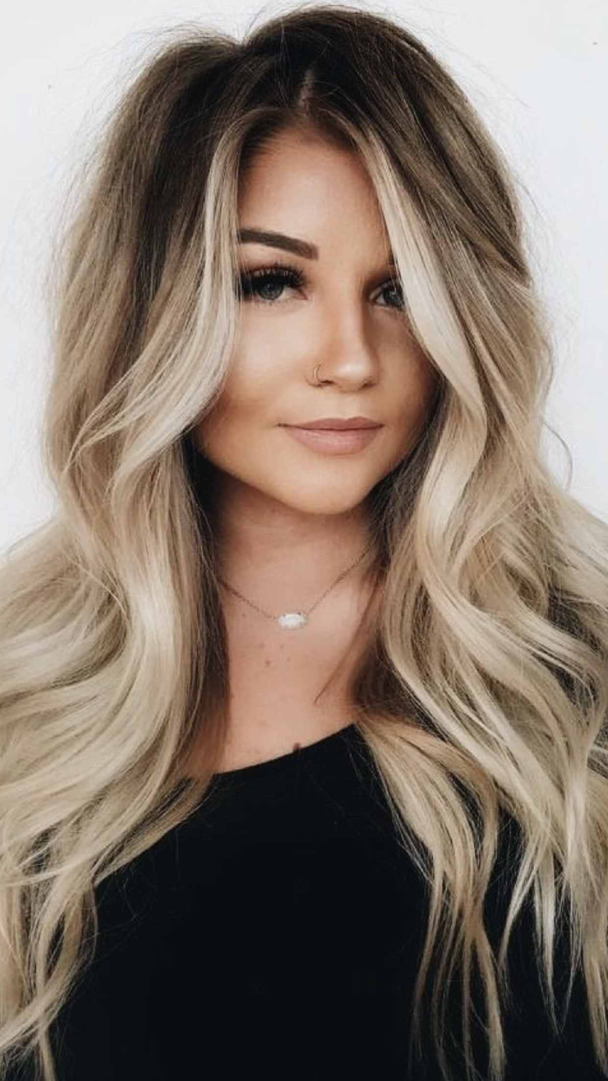 Dark Roots For Trendy Dishwater Waves Blonde Hairstyles (View 17 of 20)