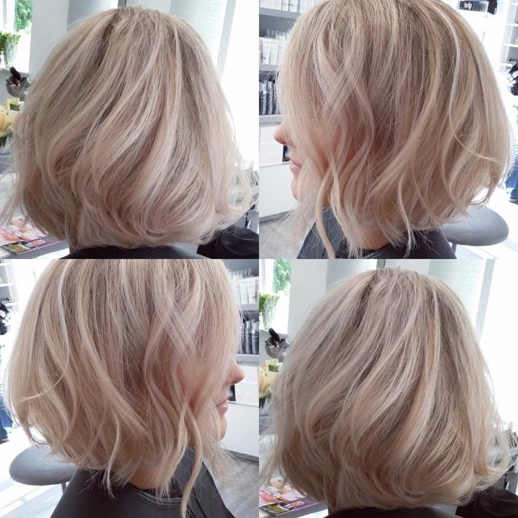 Famous Platinum Highlights Blonde Hairstyles Throughout Women's Blowout Angled Bob With Tousled Waves On Blonde Hair With (View 5 of 20)