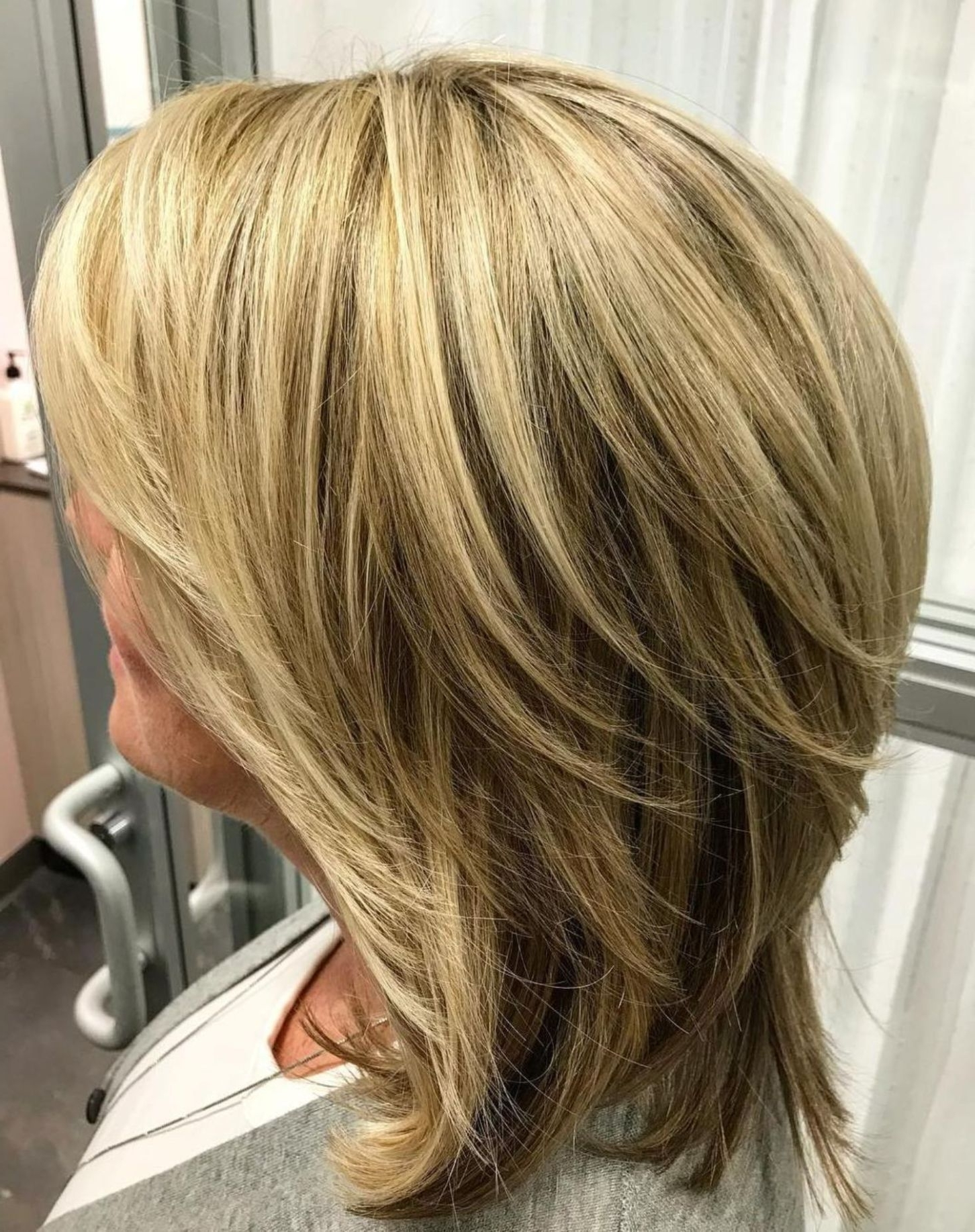 Favorite Feathered Cut Blonde Hairstyles With Middle Part In 80 Best Modern Haircuts And Hairstyles For Women Over  (View 11 of 20)