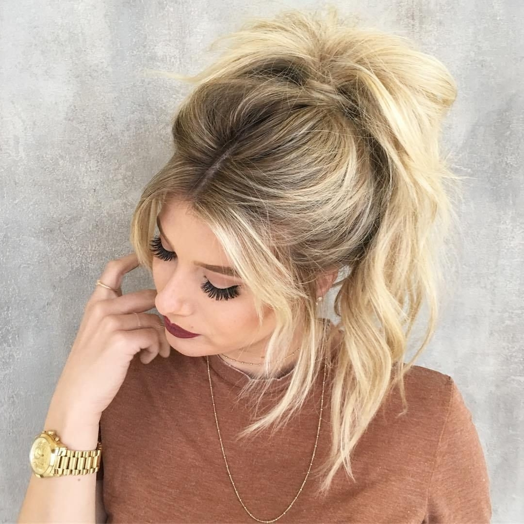 Featured Photo of Messy Pony Hairstyles For Medium Hair With Bangs