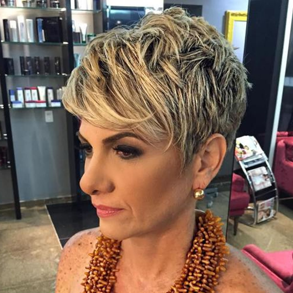 Haircuts Pertaining To Newest Undercut Blonde Pixie Hairstyles With Dark Roots (View 11 of 20)