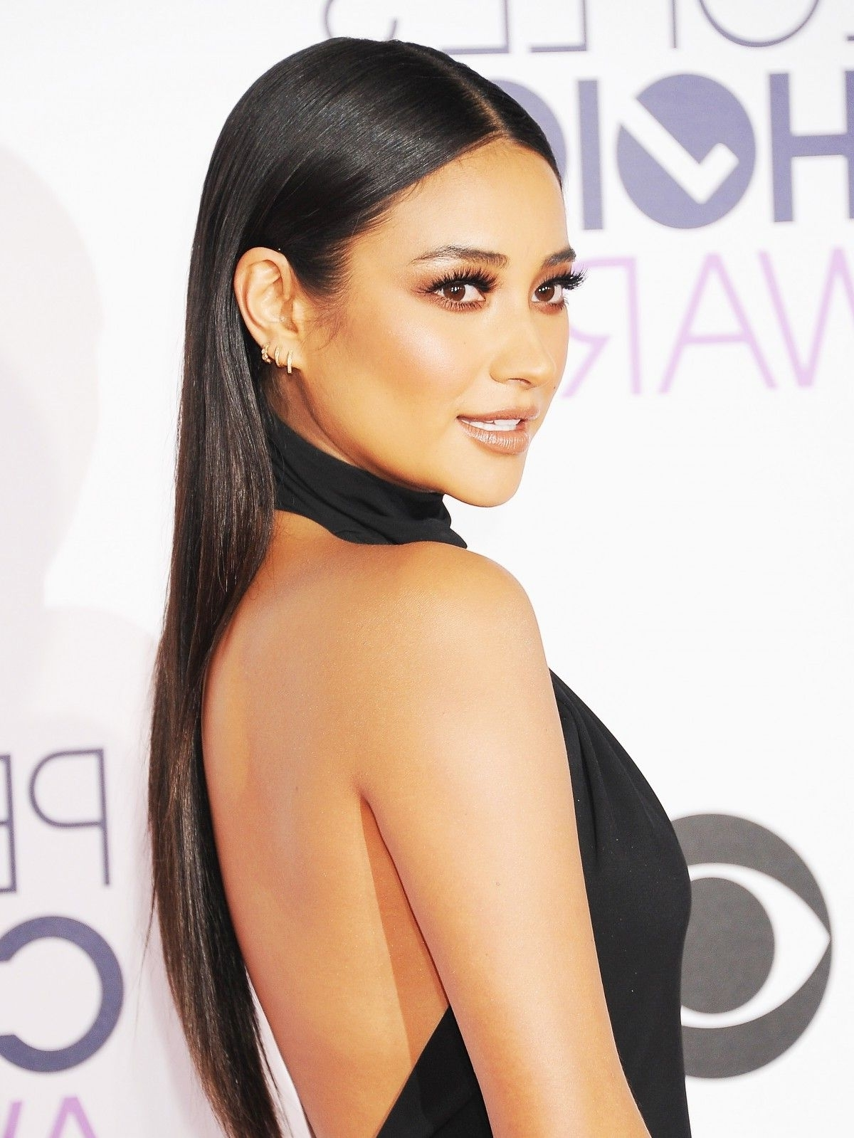 "Latest Sleek Straightened Black Ponytail Hairstyles With Get The Look: Shay Mitchell's Sleek ""less Is More"" Hair (View 8 of 20)"