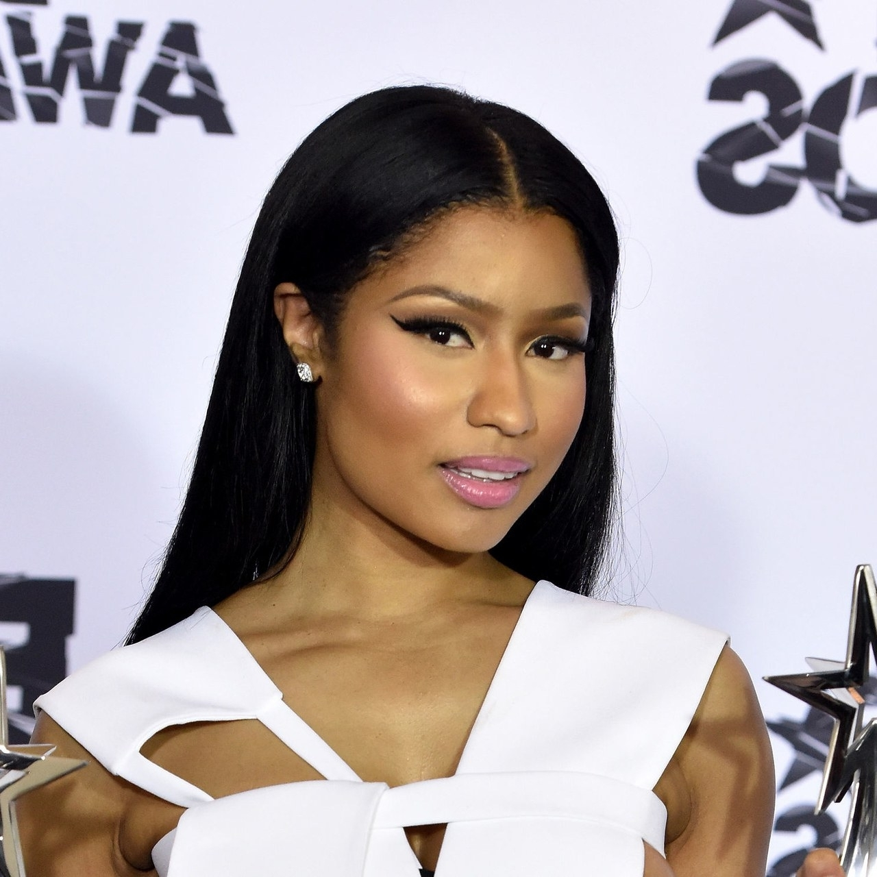 Makeup Trend: Nicki Minaj, Monica, Cassie Wear Cat Eyeliner At The In Most Recent Minaj Pony Hairstyles With Arched Bangs (Gallery 7 of 20)