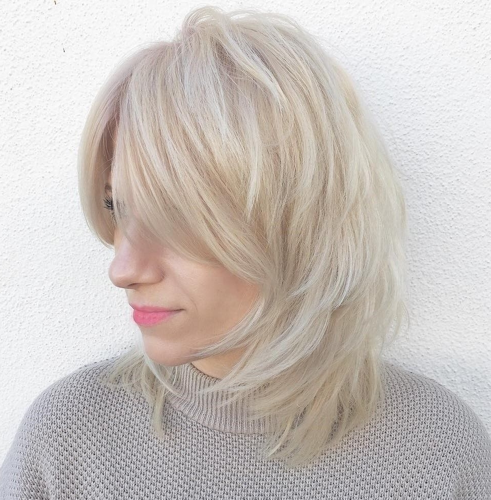 Medium Feathered Ash Blonde Hairstyle (View 8 of 20)