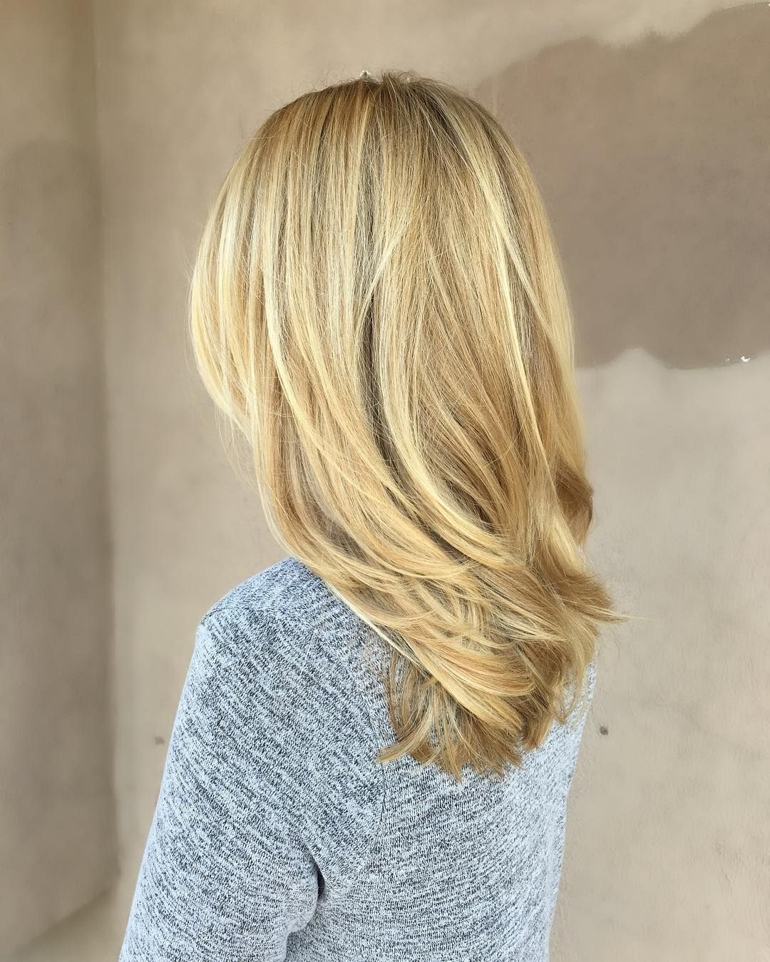 Medium Length Beige Blonde Straight Hair With Layers (View 12 of 20)