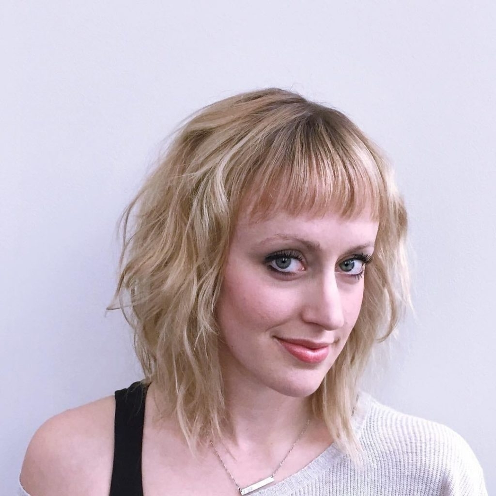 Most Current Textured Medium Length Look Blonde Hairstyles Within Women's Long Blonde Bob With Wavy Texture And Baby Bangs (View 13 of 20)