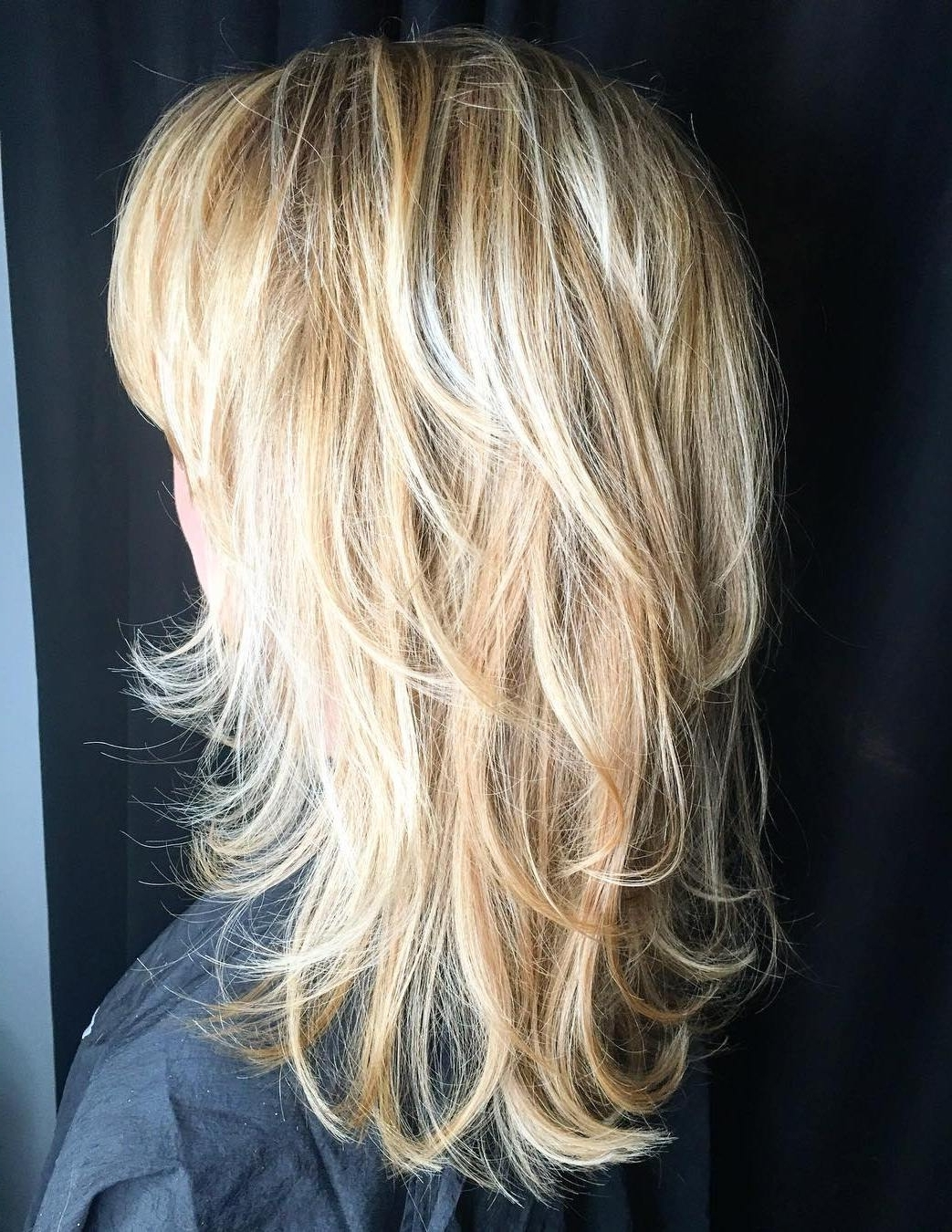 Most Popular Feathered Cut Blonde Hairstyles With Middle Part Pertaining To 50 Lovely Long Shag Haircuts For Effortless Stylish Looks (View 15 of 20)