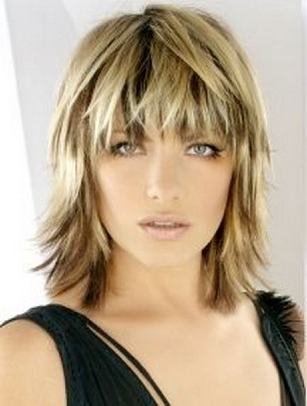 Most Recently Released Shaggy Chin Length Blonde Bob Hairstyles With Regard To Blonde Medium Length Choppy Shag Haircut With Wispy Bangs And Dark (View 14 of 20)