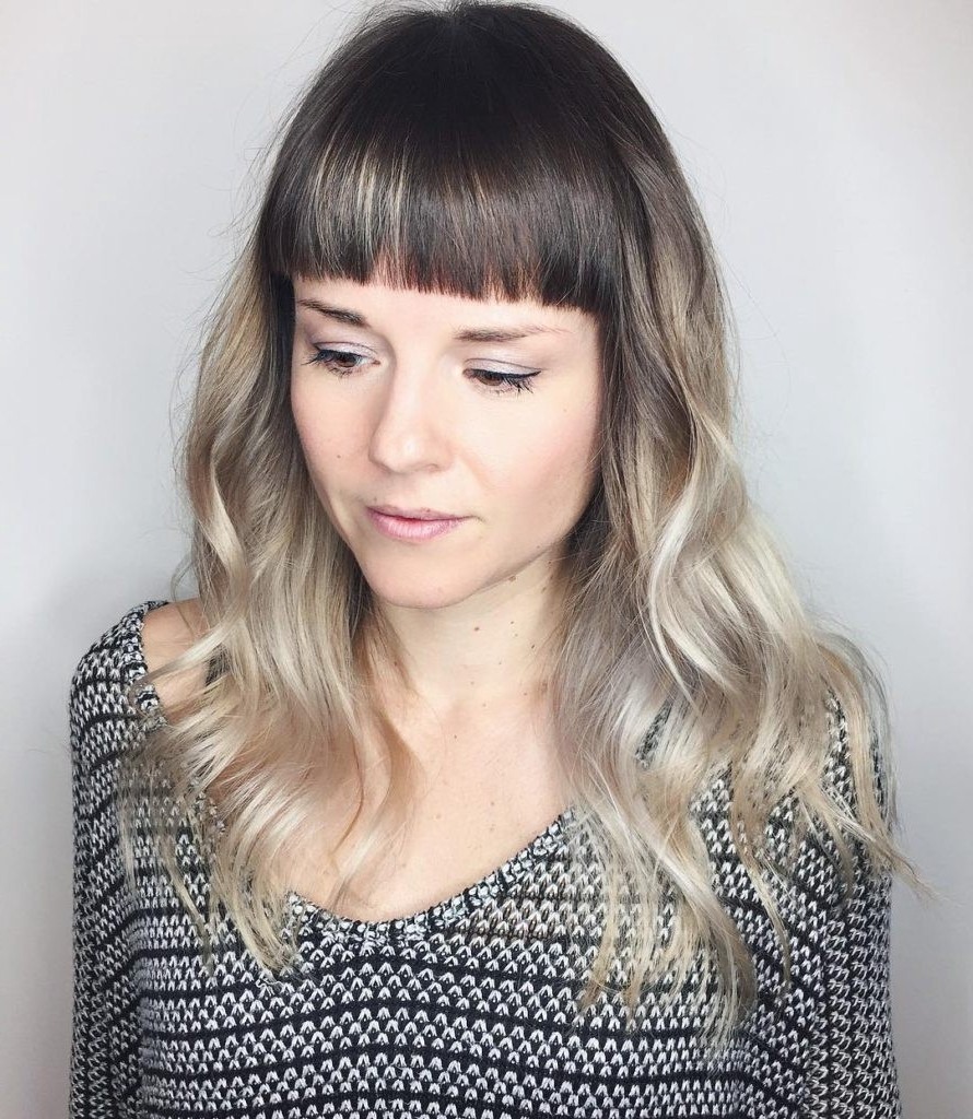 Polished Wavy Layered Cut With Blunt Baby Bangs And Cool Blonde Pertaining To Best And Newest Blonde Color Melt Hairstyles (View 15 of 20)