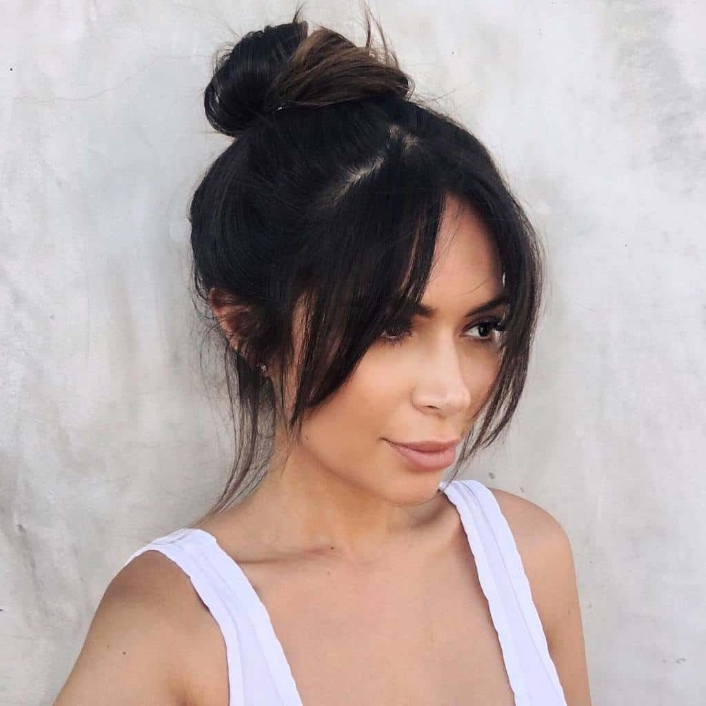 Ponytail With Bangs: 10 Styles To Turn Drab To Fab In Most Current Side Bangs And Pony Hairstyles For Wavy Hair (View 4 of 20)
