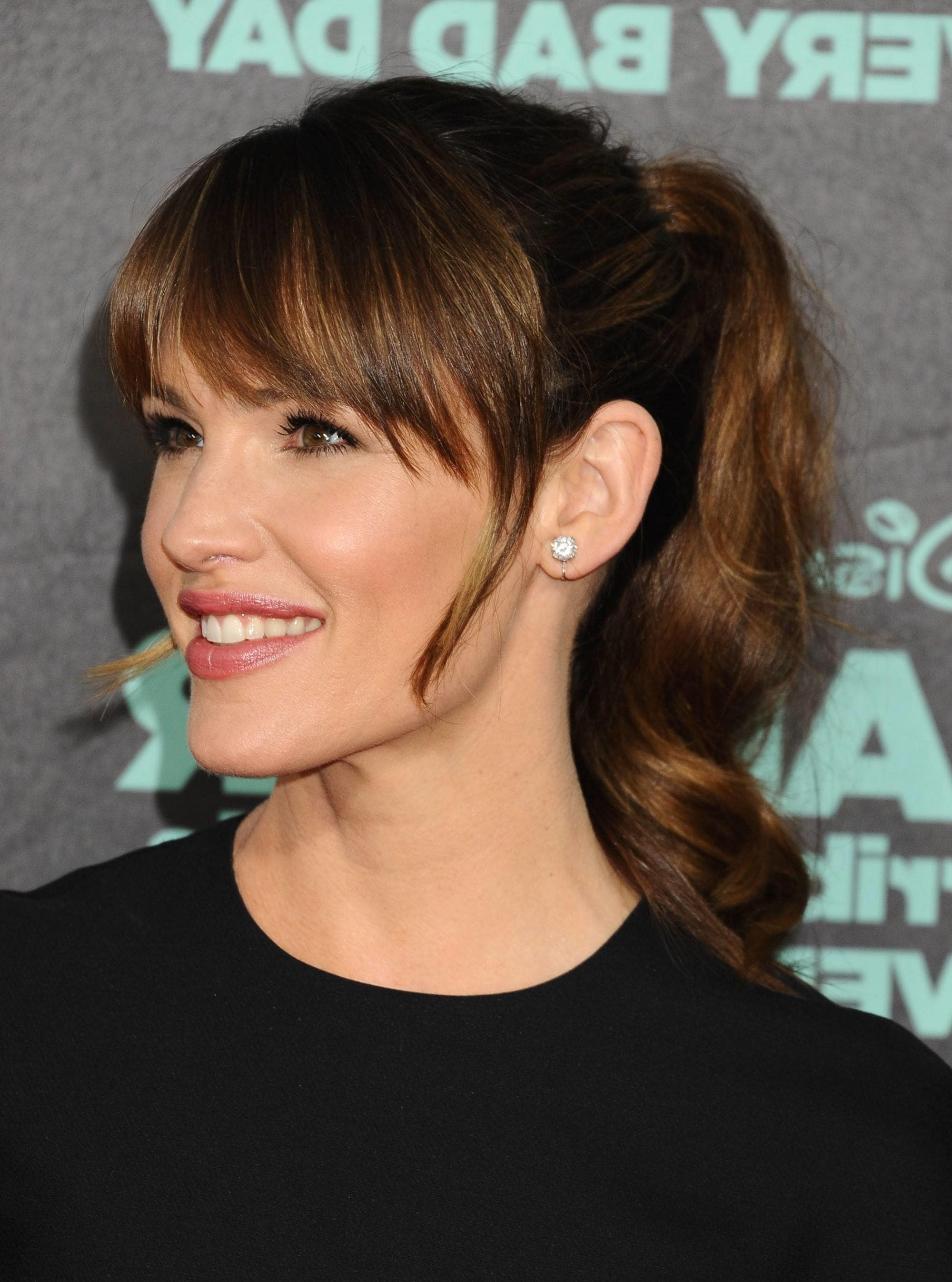 Ponytail With Bangs: 7 Fresh New Ways To Wear The Style Intended For Famous Side Bangs And Pony Hairstyles For Wavy Hair (View 14 of 20)