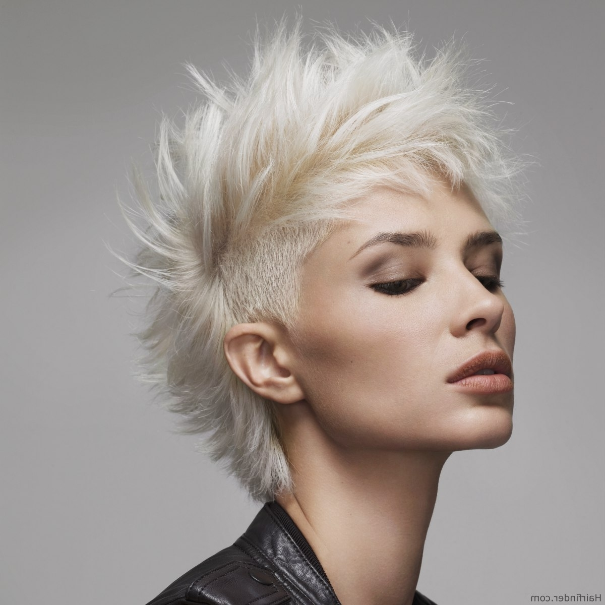 Short And Spiky Platinum Blonde Hair With An Undercut Throughout Well Known Spiked Blonde Mohawk Hairstyles (View 3 of 20)