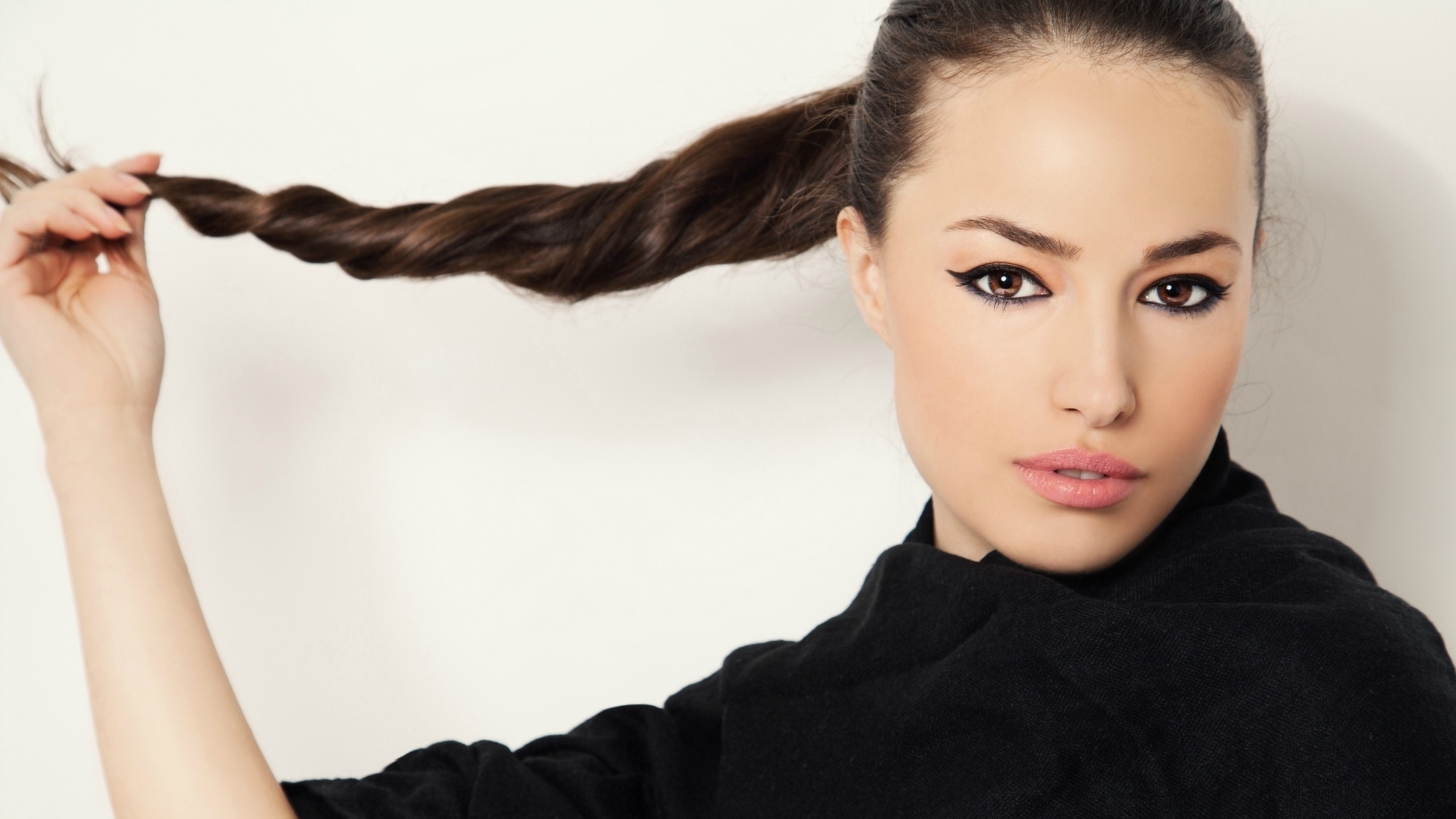 Stylecaster Intended For Newest Neat Ponytail Hairstyles With Voluminous Curls (View 2 of 20)