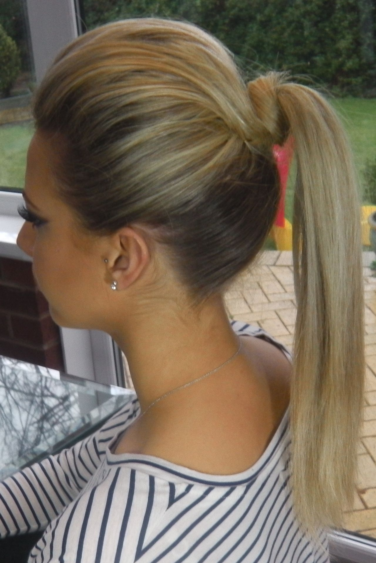 "The ""barbie Ponytail"" – The Knot Lifting The Pony & Volume Up Top Inside Most Recently Released Classy Flower Studded Pony Hairstyles (View 17 of 20)"