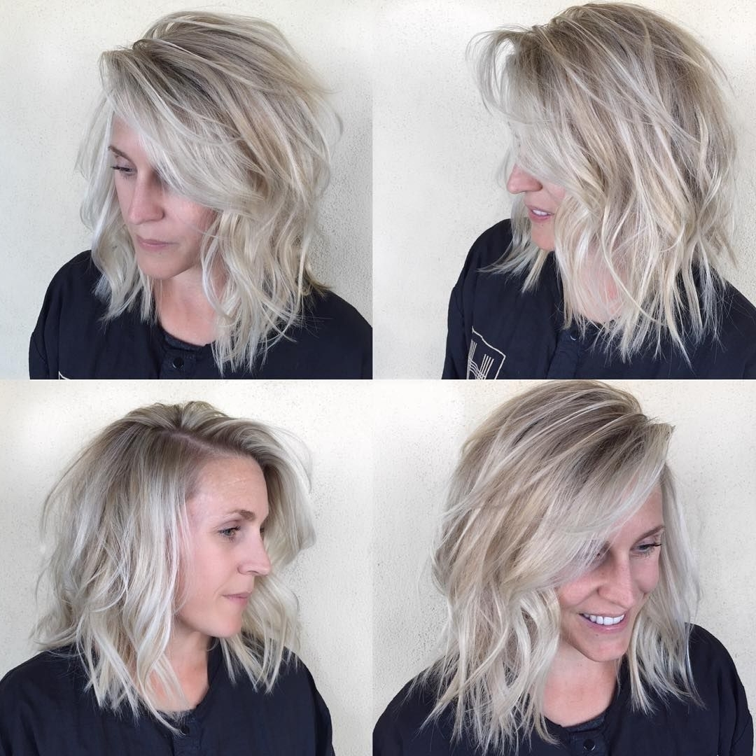 This Undone Textured Lob With Long Side Swept Bangs And Pale Blonde For Most Current Side Swept Warm Blonde Hairstyles (View 18 of 20)